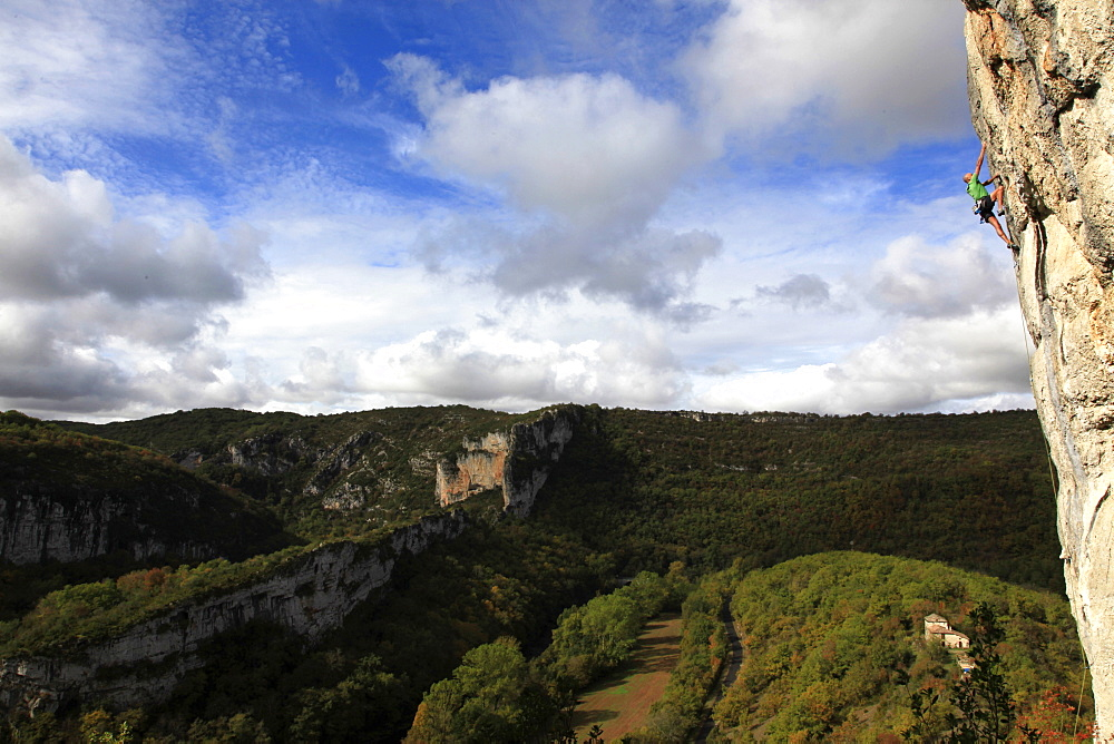 A climber scales cliffs in the Aveyron region, southwest France, Europe