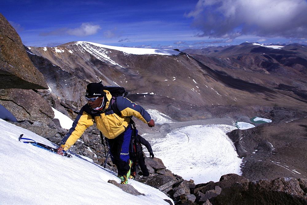 A climber ascending Mentok I, 6200m, high above Tso Mori lake, Ladakh, Himalayas, India, Asia - 802-285