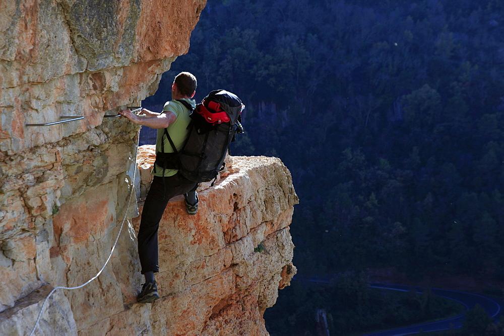 A climber scaling a Via Ferrata at Siurana, Catalonia, Spain, Europe - 802-286