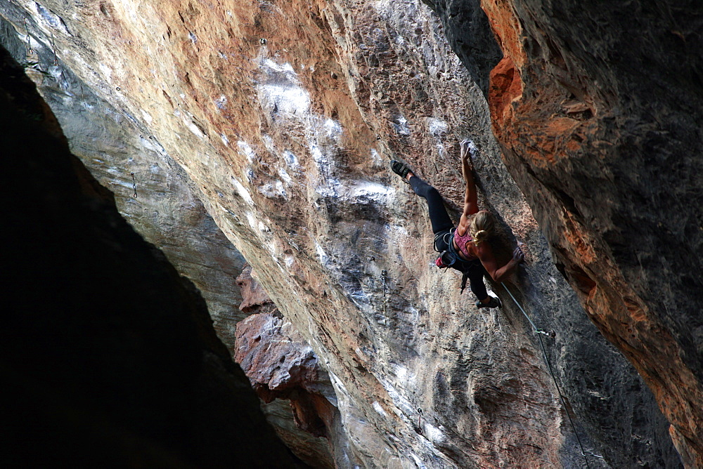 A climber scaling limestone cliffs in the jungle at Serra do Cipo, Minas Gerais, Brazil, South America - 802-290