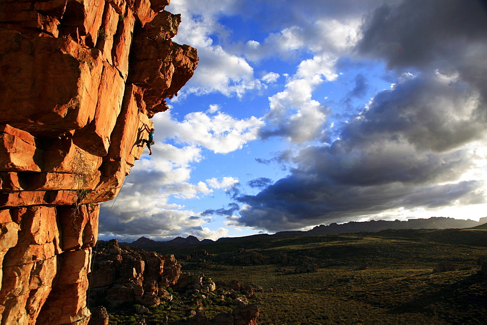 A climber scales cliffs in The Cederberg, Western Cape, South Africa, Africa - 802-295