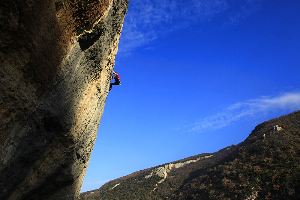 A climber scales cliffs at Buoux, Provence, France, Europe - 802-296
