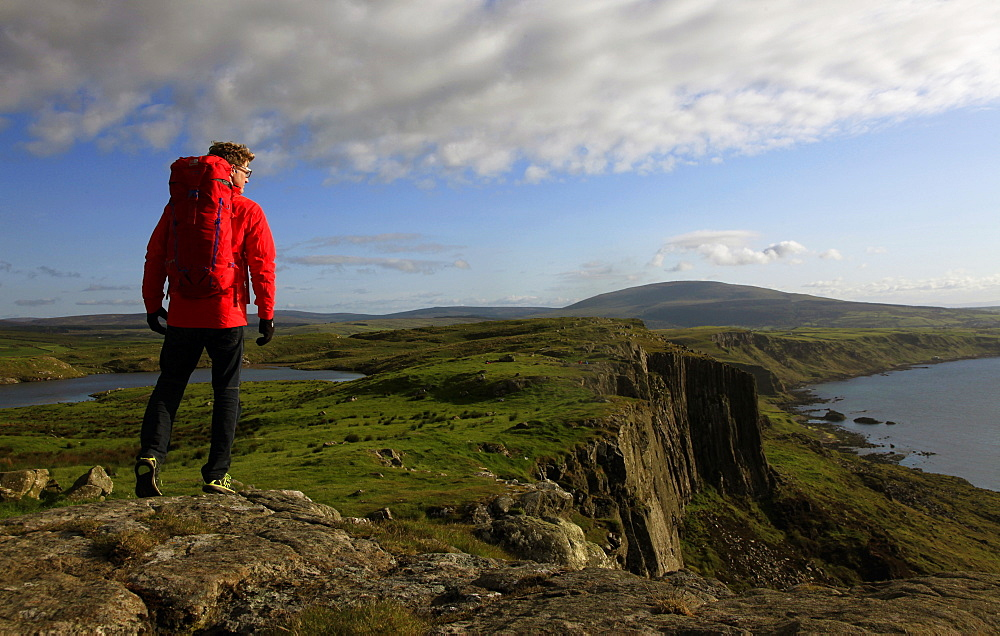 A hiker at Fair Head, County Antrim, Ulster, Northern Ireland, United Kingdom, Europe - 802-298