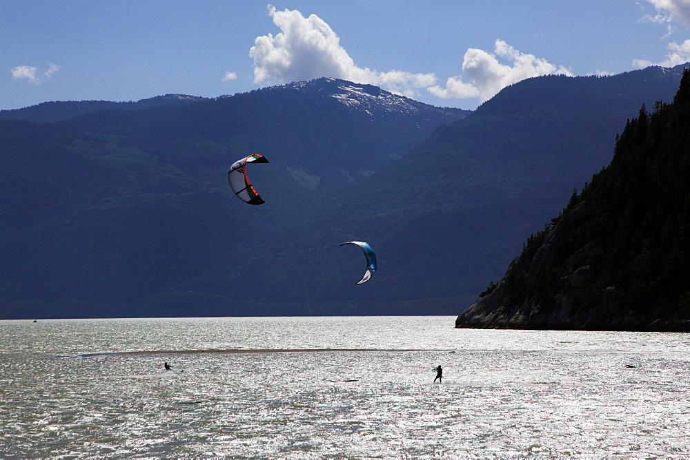 Two kite surfers on Howe Sound at Squamish, British Columbia, Canada, North America - 802-310