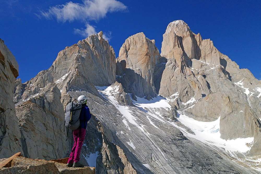 A mountaineer looks up towards Cerro Fitz Roy, El Chalten Massif, Patagonia, Argentina, South America