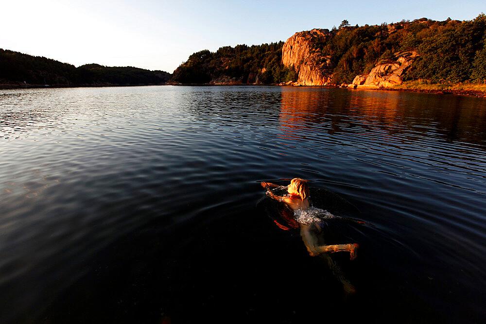 A woman swimming on the Bohuslan coast, Sweden, Scandinavia, Europe