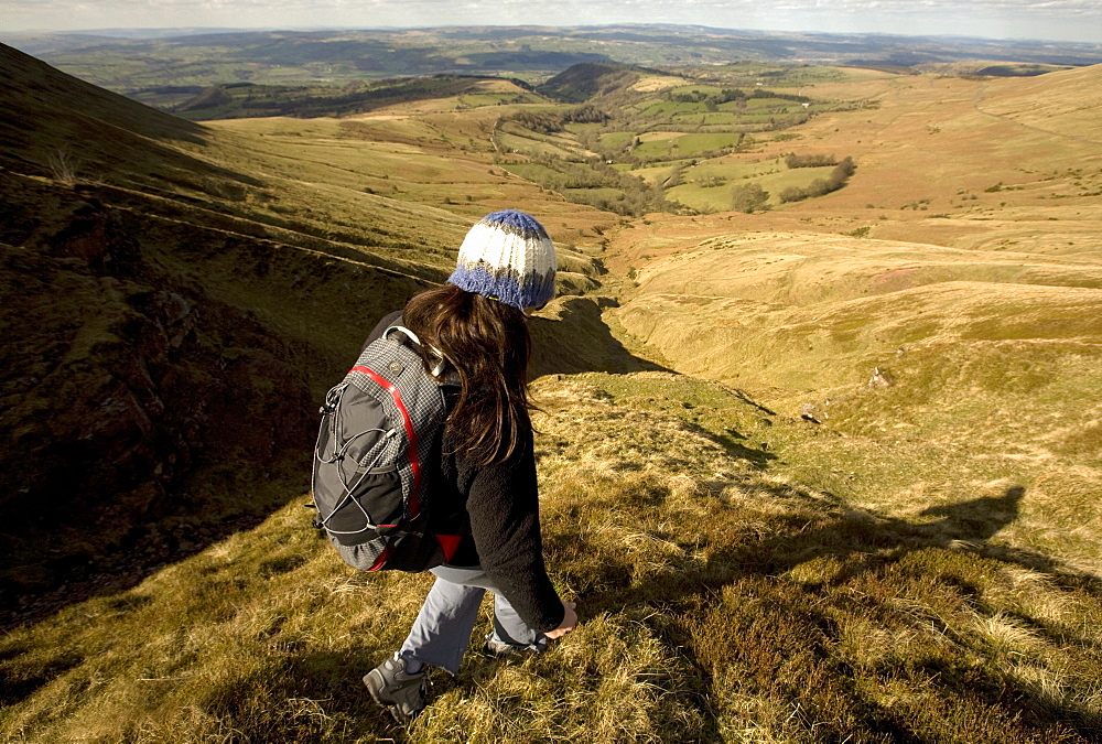 A hiker enjoys solitude in the hills above Hay-on-Wye, on the eastern edge of the Brecon Beacons National Park, Monmouthshire, Wales, United Kingdom, Europe