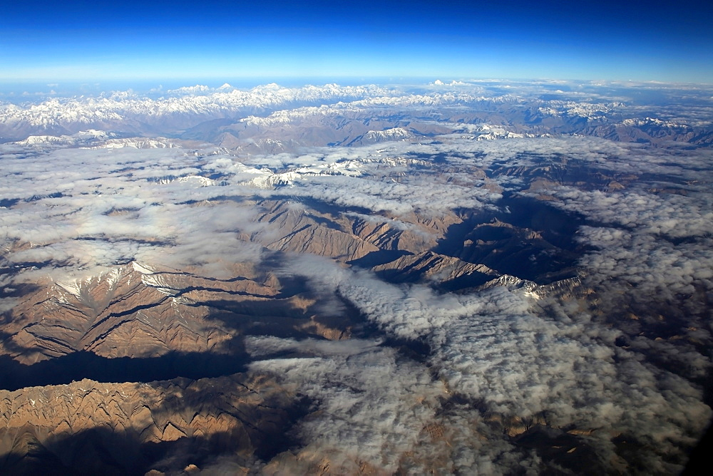 The Zanskar Range of the Indian Himalaya seen from the air, looking north west towards the western Karakorum mountains and K2 in the distance, India, Asia