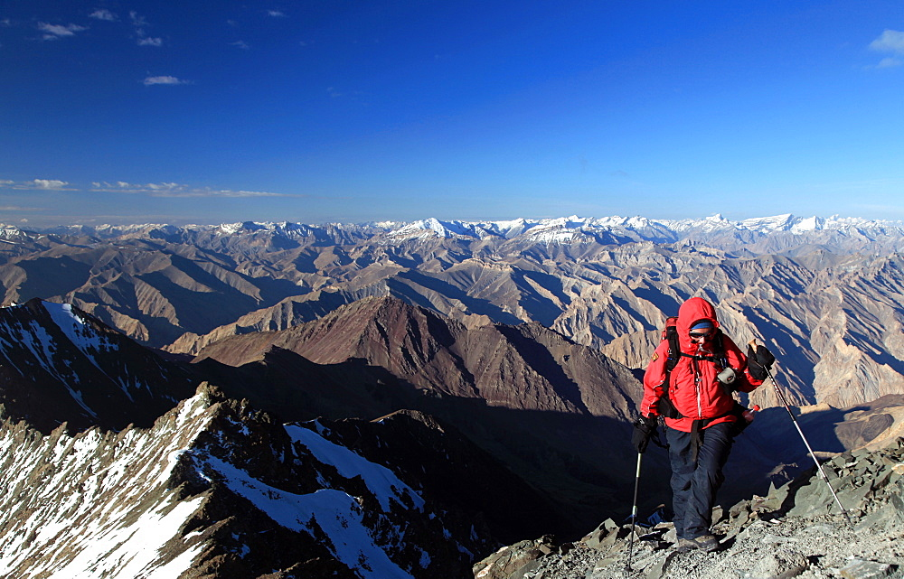 A climber makes her way up the summit ridge of Stok Kangri at 6137 metres, a popular and easily accessible trekking peak in the northern Zanskar Range, Ladakh, India, Asia