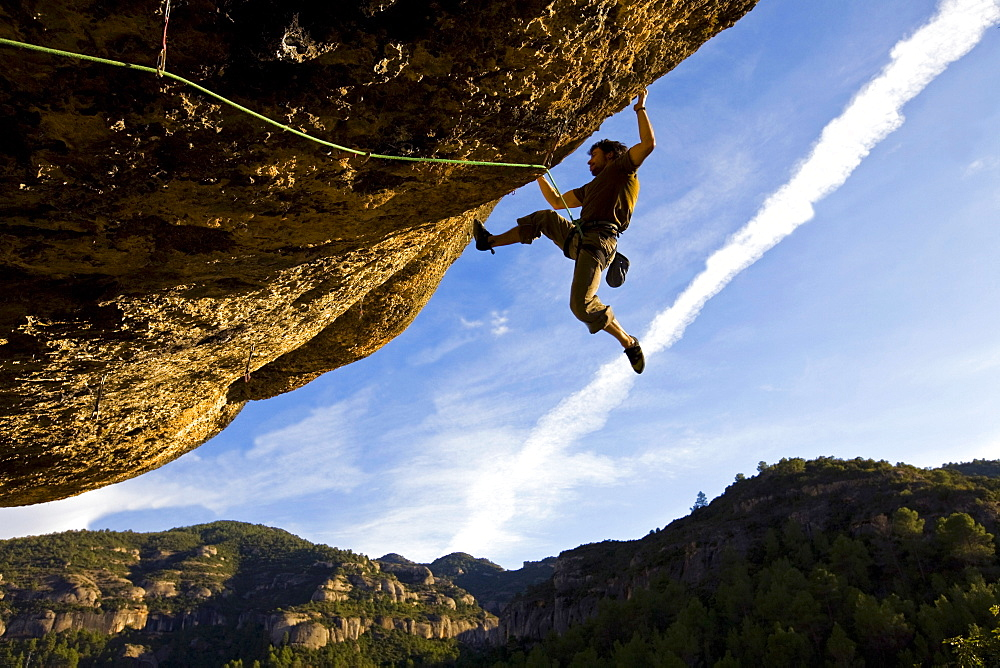 A climber tackles an exceptionally difficult, F8c graded, route on a big overhang at the cliffs of Margalef, underneath Montsant, near Lleida and Tarragona, Catalunya, Spain, Europe - 802-64