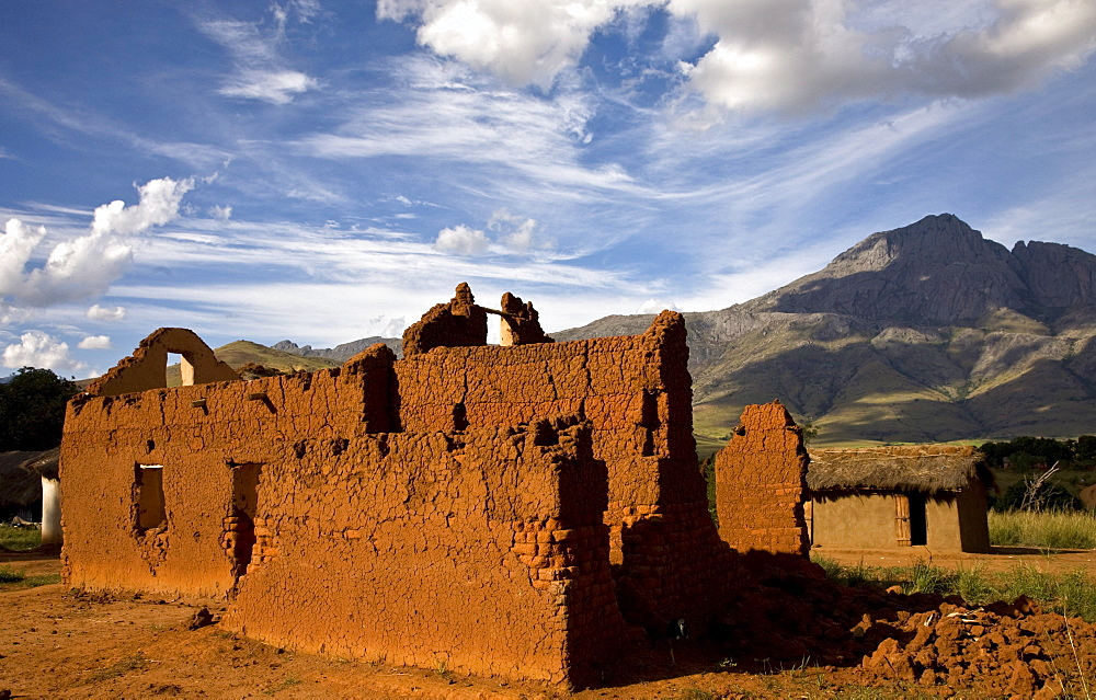 Laterite brick buildings in the village of Sovakimby, Andringitra National Park, Madagascar, Africa