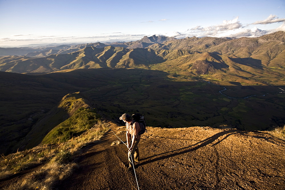 A climber descending a long granite ridge from the upper Tsaranoro Massif, Andringitra National Park, southern Madagascar, Africa