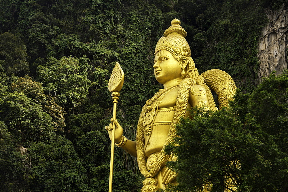 Statue of Hindu God, Lord Muruganat, at the entrance to the Batu Caves, Gombak, Malaysia, Southeast Asia, Asia