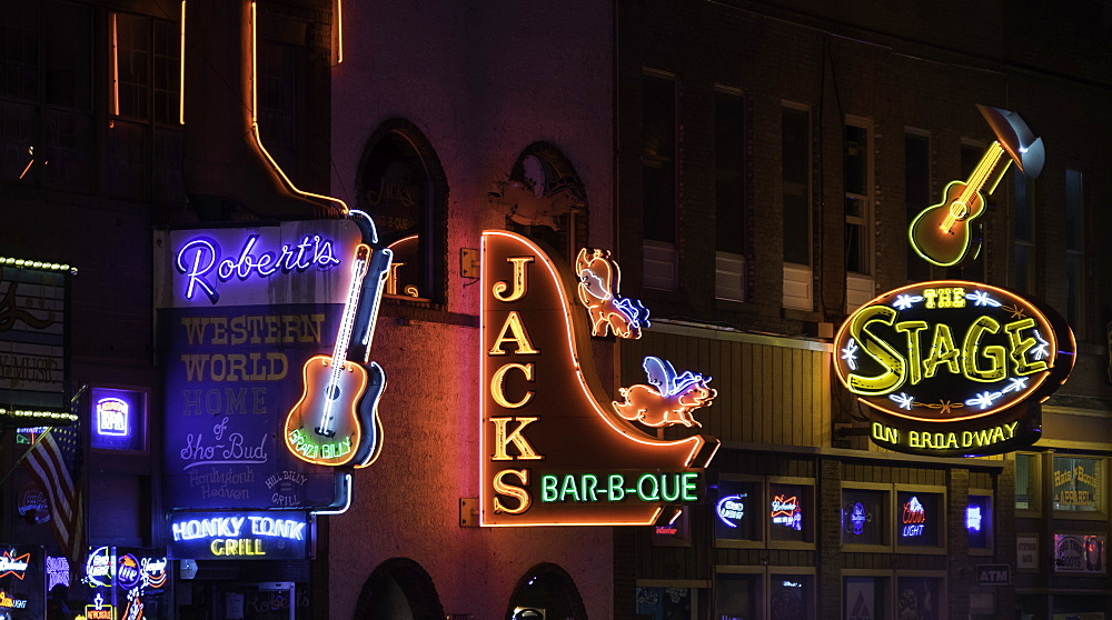 Neon signs and historic music clubs along Lower Broadway in Nashville, Tennessee, United States of America, North America - 803-286