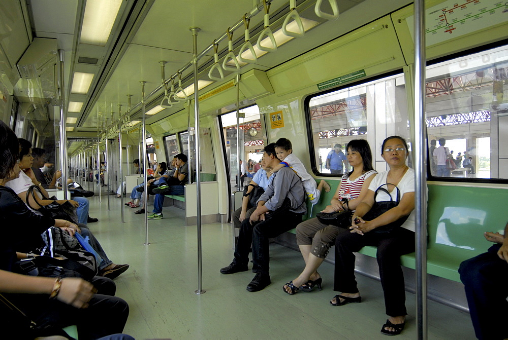 Passengers on a mass rapid transit train in Singapore, Southeast Asia, Asia