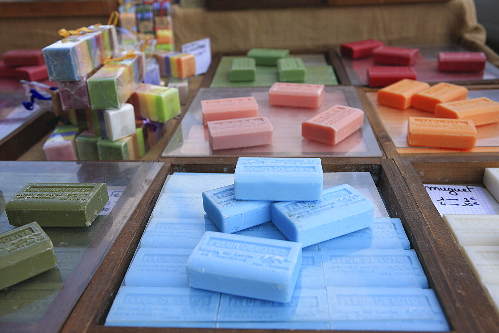Different types of soap on stall in a street market on the French Riviera, Provence, France, Europe