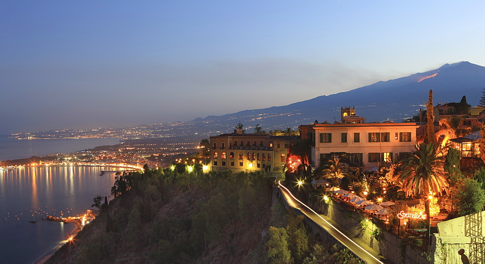 View from Taormina at dusk of coast and Mount Etna, Sicily, Italy, Europe