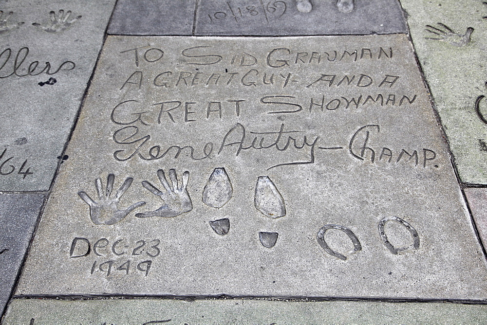 Hand and foot prints of Gene Autry, Manns (Graumans) Chinese Movie Theatre, Hollywood Boulevard, Los Angeles, California, United States of America, North America