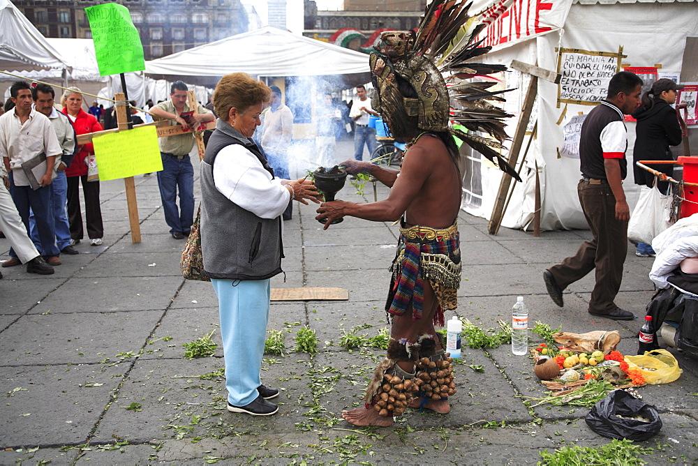 Aztec folk healer, shaman practising spiritual cleansing, Zocalo, Plaza de la Constitucion, Mexico City, Mexico, North America