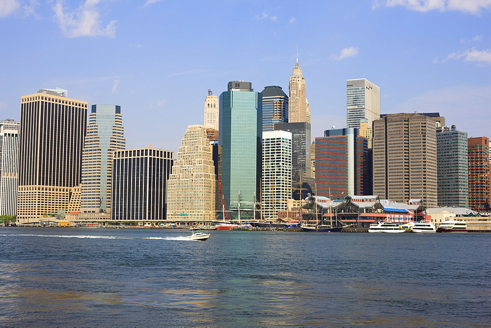 Lower Manhattan skyline and South Street Seaport across the East River, New York City, New York, United States of America, North America