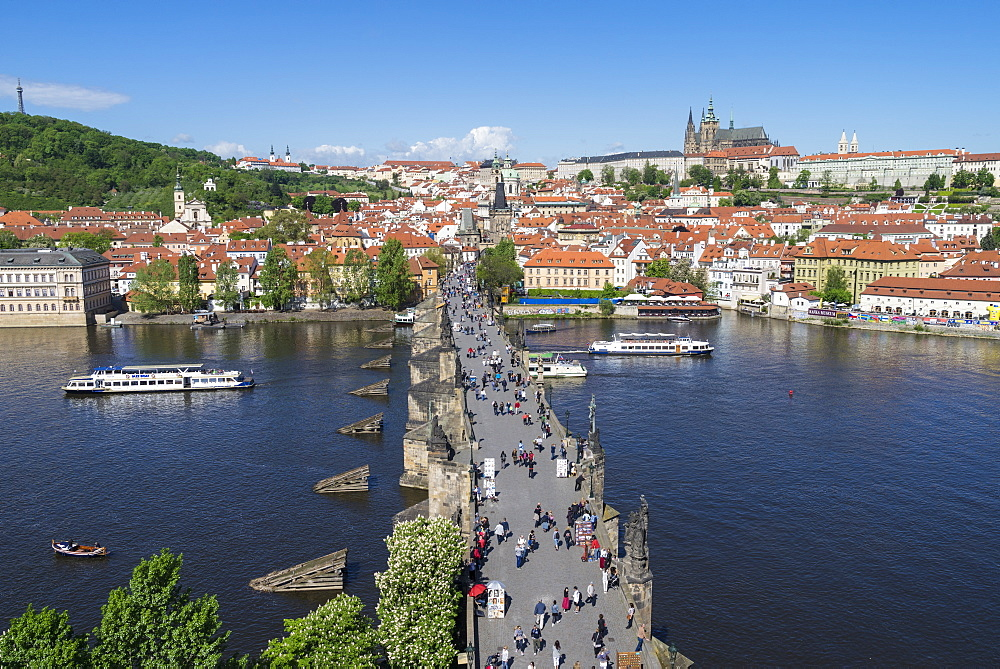 High angle view of Charles Bridge looking towards the Castle District, Royal Palance and St. Vitus's Cathedral, UNESCO World Heritage Site, Prague, Czech Republic, Europe