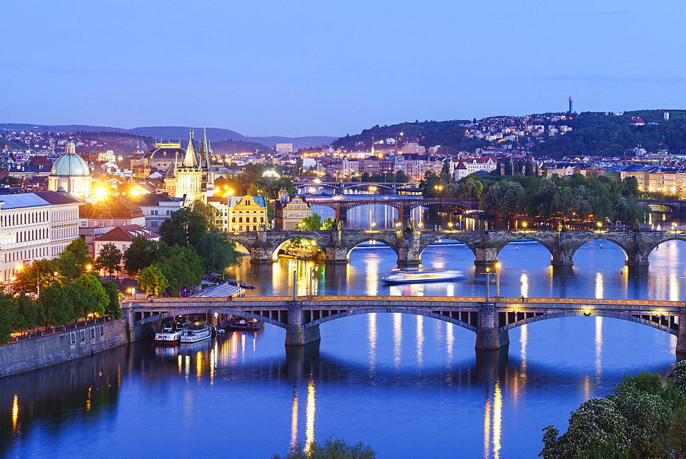 Looking down the Vltava River to Manesuv, Charles and Legii bridges connecting the Old Town to Mala Strana, Prague Castle and Hradcany, Prague, Czech Republic, Europe