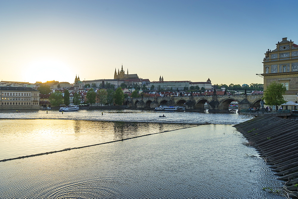 Sunset over the Vltava River looking towards St. Vitus's Cathedral and the Castle District, Prague, Czech Republic, Europe