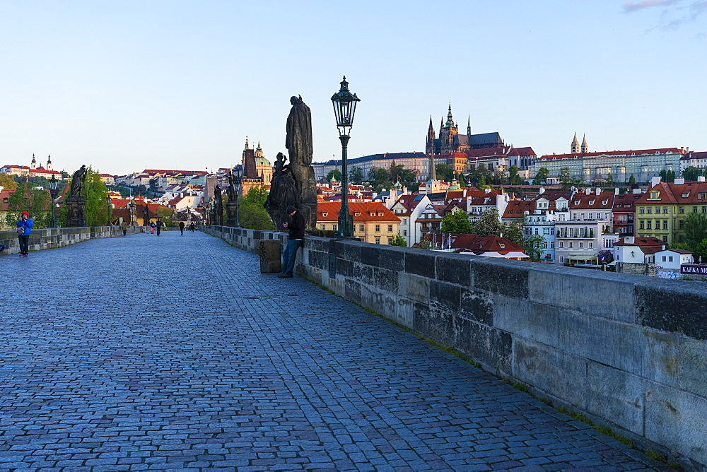 Early morning on Charles Bridge looking towards Prague Castle and Hradcany, UNESCO World Heritage Site, Prague, Czech Republic, Europe