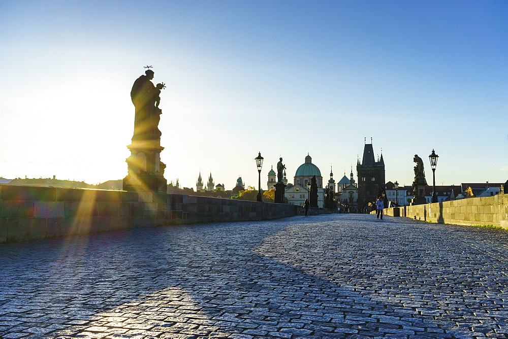 Early morning on Charles Bridge looking towards the Old Town, UNESCO World Heritage Site, Prague, Czech Republic, Europe