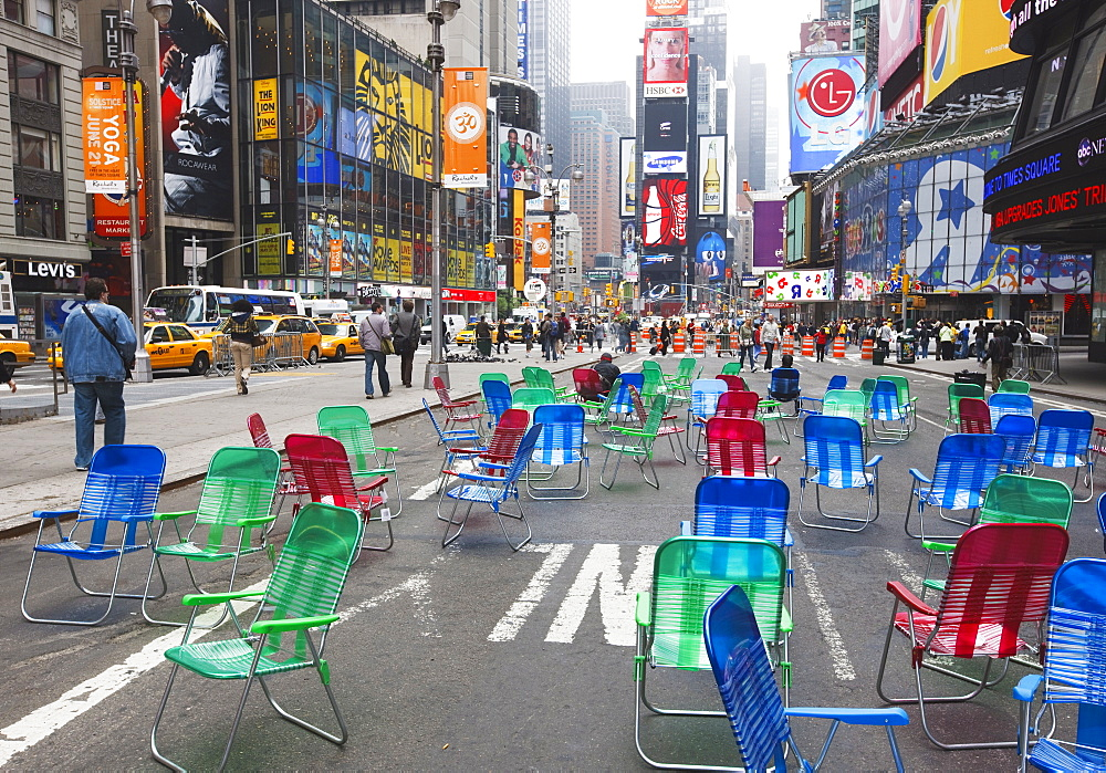 Garden chairs in the road for the public to sit in the pedestrian zone of Times Square, New York City, New York, United States of America, North America