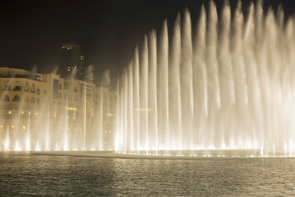 The Dubai Fountain, the largest of its kind in the world that shoots water 150 metres into the air to accompanying music and light show and stands in front of the Burj Khalifa, formerly the  Burj Dubai, Downtown Burj Dubai, United Arab Emirates, Middle East