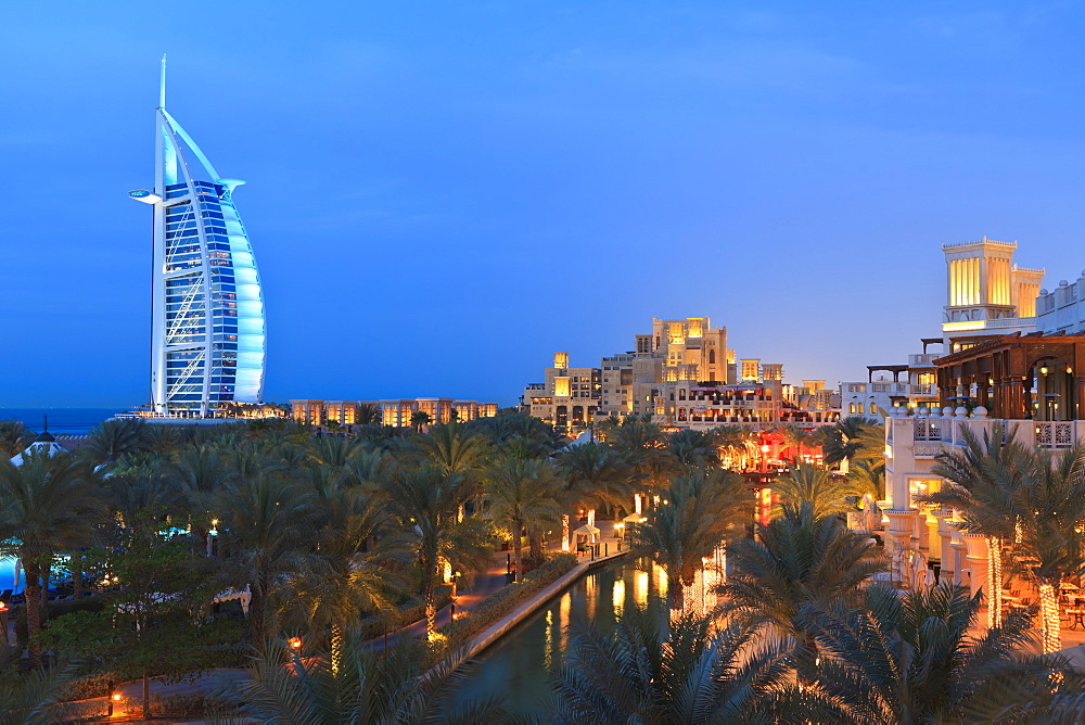 Burj Al Arab viewed from the Madinat Jumeirah Hotel at dusk, Jumeirah Beach, Dubai, United Arab Emirates, Middle East