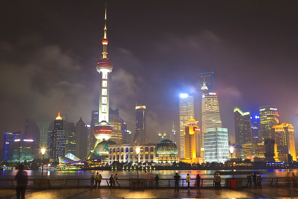 Pudong skyline at night across the Huangpu River, Oriental Pearl tower on left, Shanghai, China, Asia - 808-628