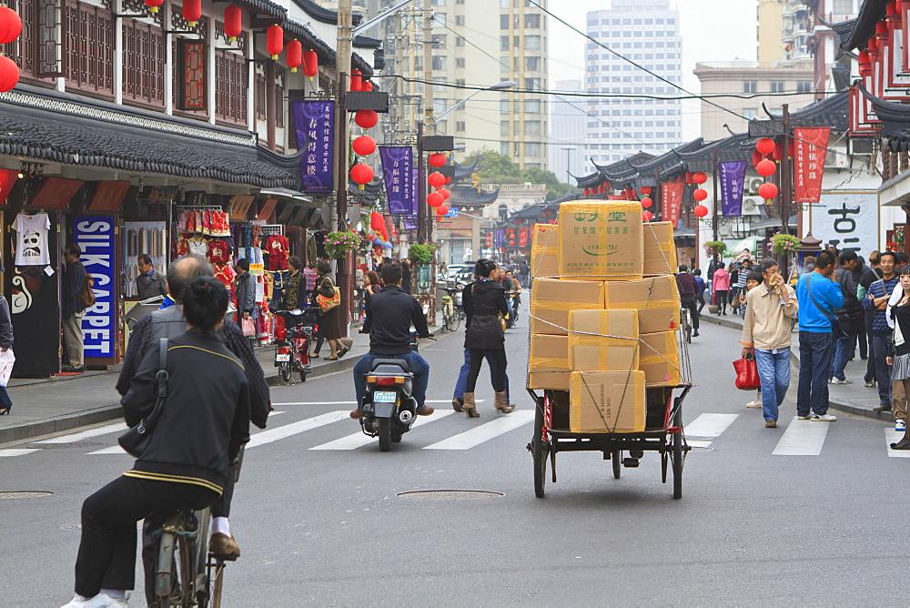 Pedestrians and traffic on Shanghai Old Street, a restored traditional neighbourhood, Nanshi, Shanghai, China, Asia