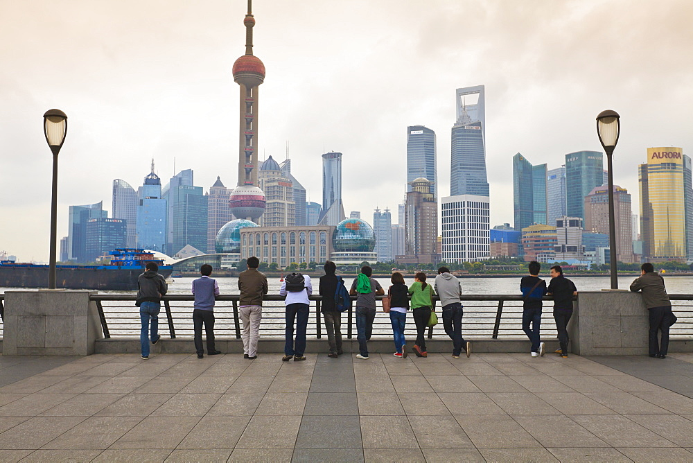 People viewing the Pudong skyline and the Oriental Pearl Tower from the Bund, Shanghai, China, Asia - 808-766