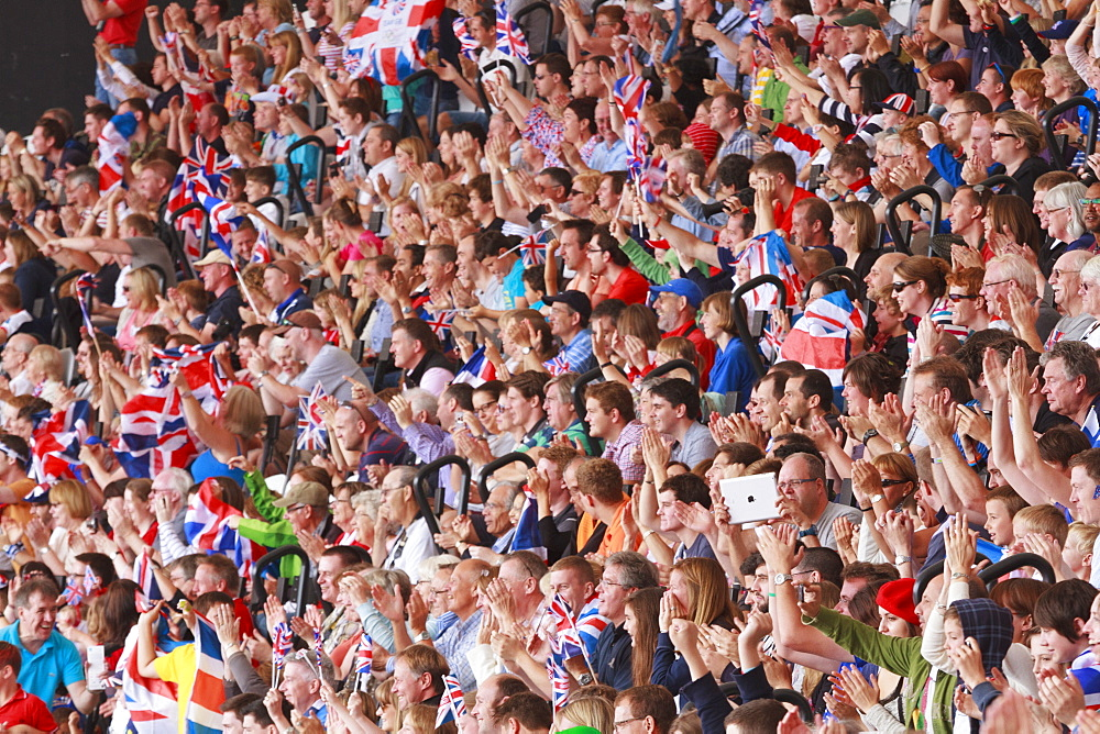 Large crowd of British spectators with Union flags in a sports arena, London, England, United Kingdom, Europe