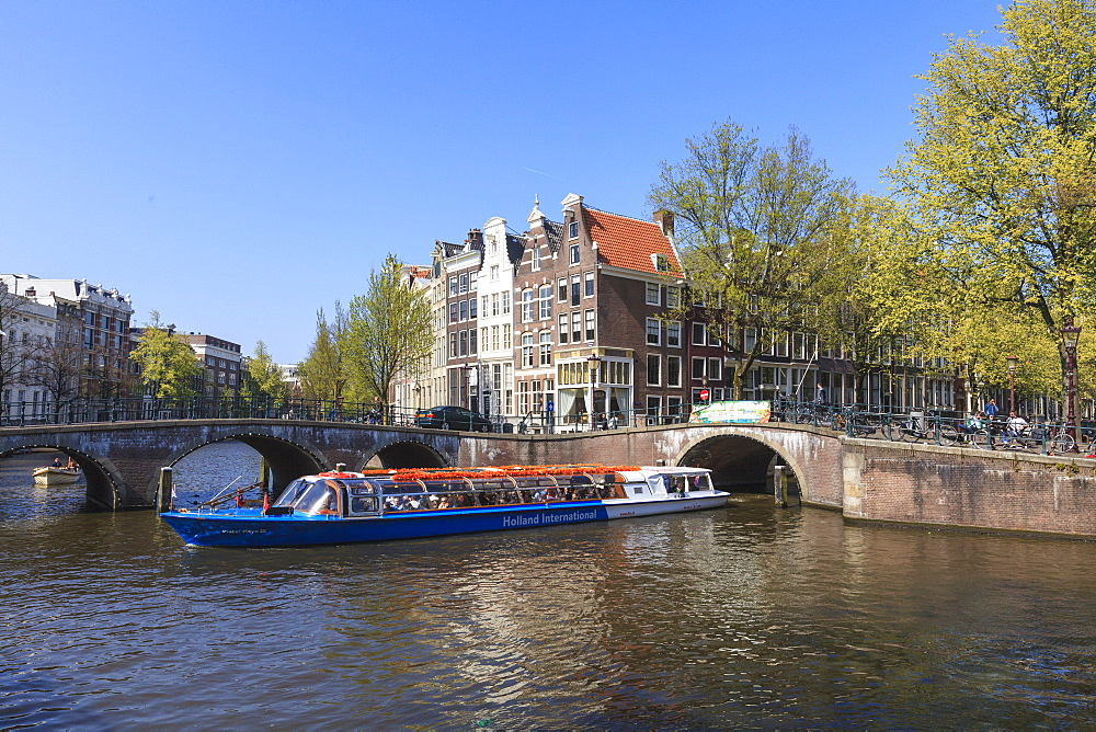 Tourist boat on the Keizersgracht Canal, Amsterdam, Netherlands, Europe