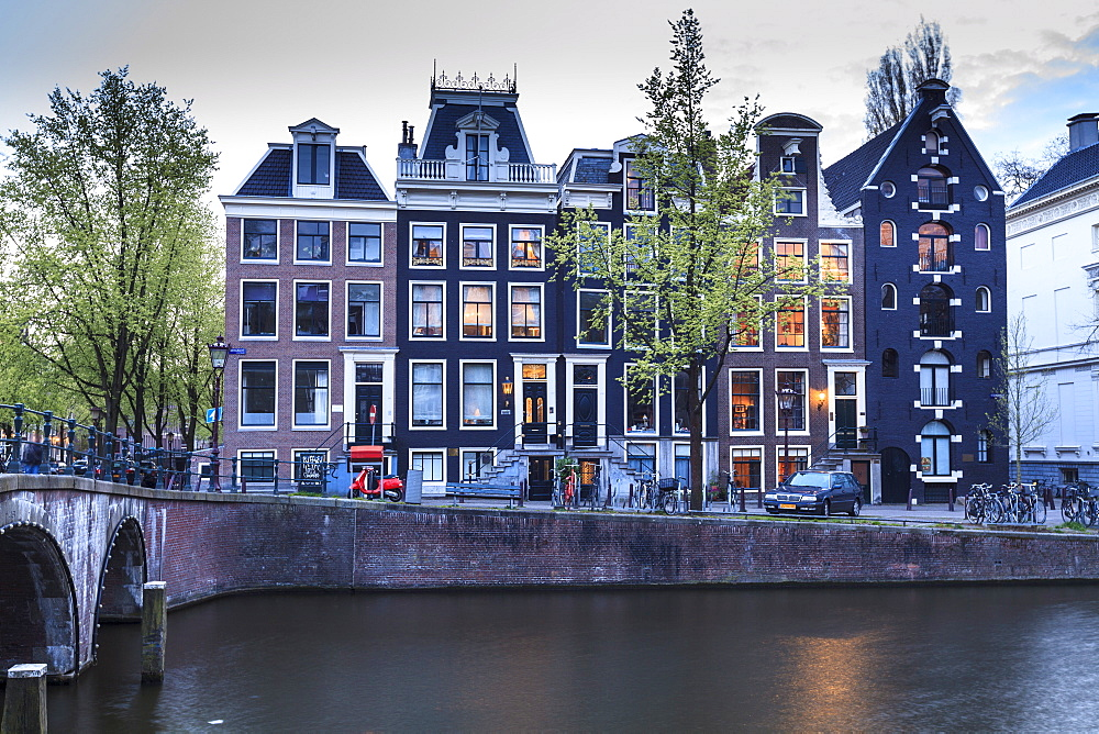 Old gabled houses line the Keizersgracht canal at dusk, Amsterdam, Netherlands, Europe