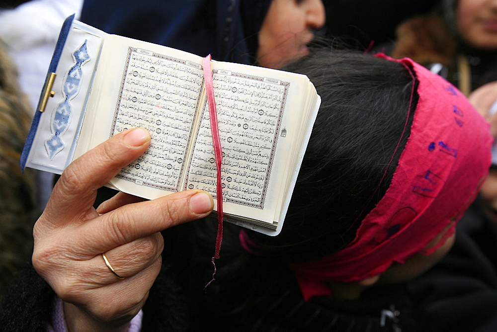 Koran being held during a Muslim demonstration, Paris, France, Europe