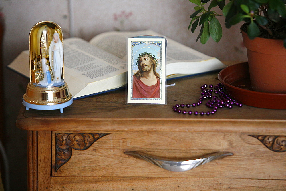 Religious paraphernalia in a bedroom, Chedde, Haute Savoie, France, Europe