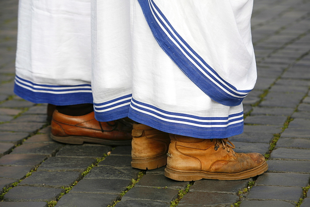 Shoes of the Missionaries of Charity, a congregation founded by Mother Teresa, and Sanpietrini pavingstones, Rome, Lazio, Italy, Europe