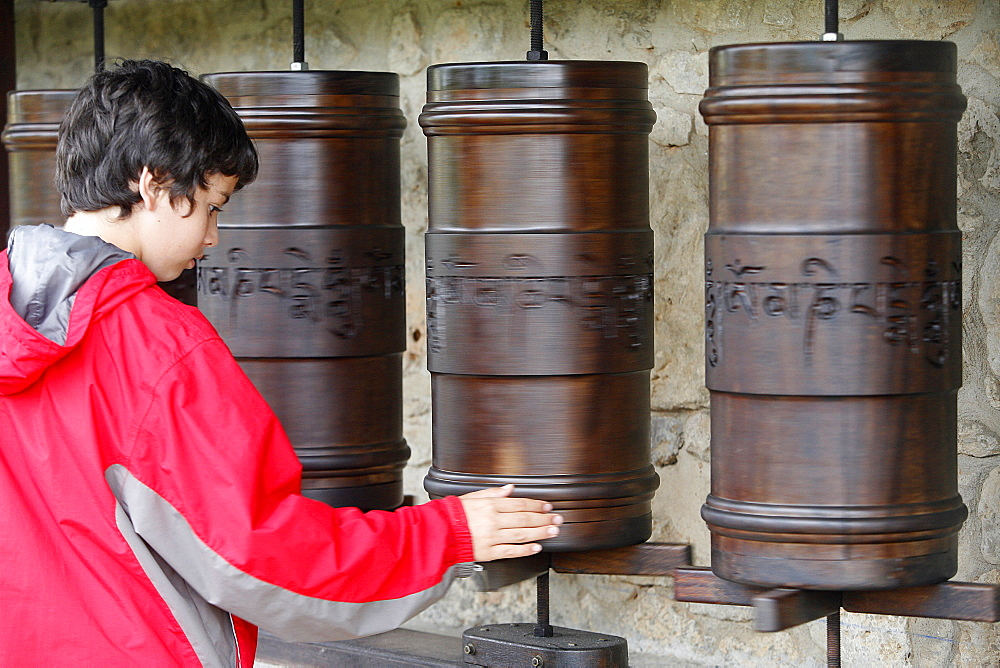 Prayer wheels in Dhagpo Kagyu Ling Tibetan Buddhist monastery, Saint-Leon sur Vezere, Dordogne, France, Europe