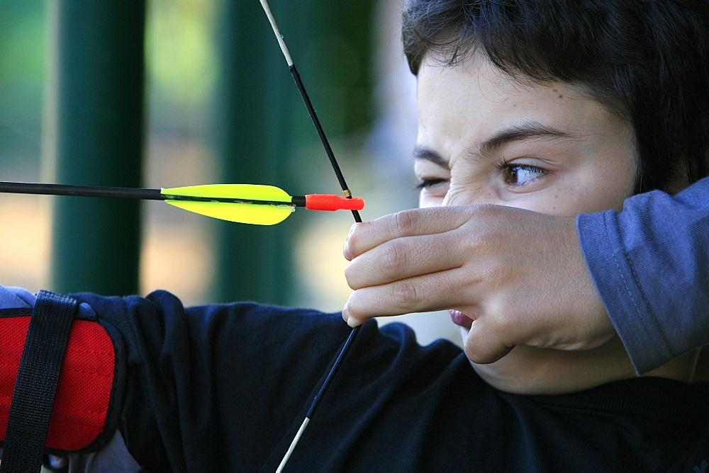 Boy doing archery, Forges-les-Eaux, Seine Maritime, France, Europe