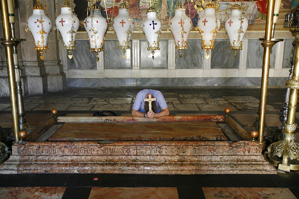 Worshipper at the Stone of the Anointing, Church of the Holy Sepulchre, Jerusalem, Israel, Middle East