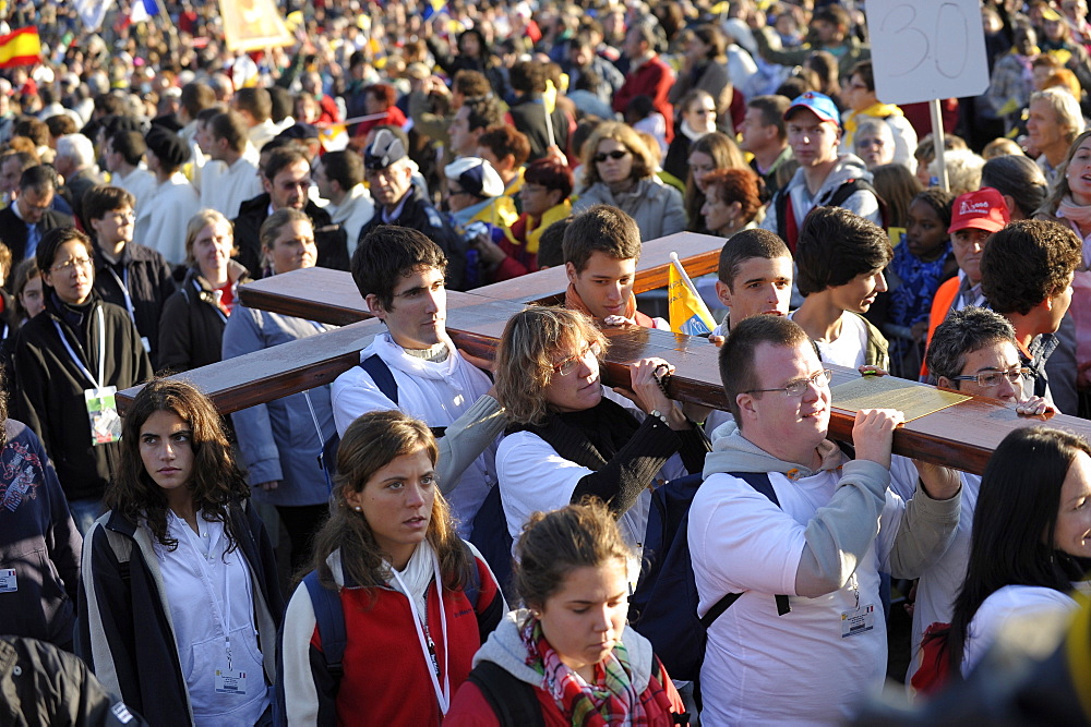 Youth carrying World Youth Days cross during the Pope's visit to Lourdes, Hautes Pyrenees, France, Europe
