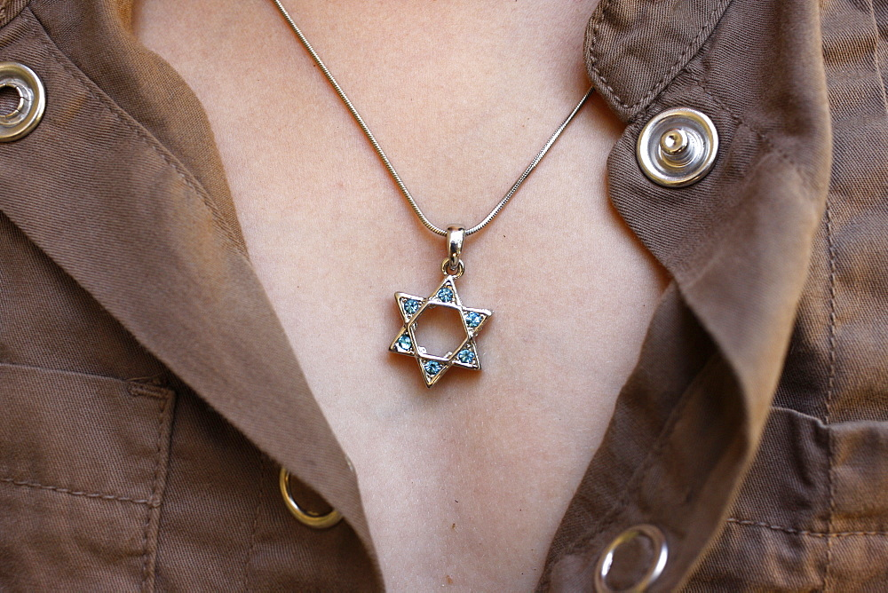 A 10-year-old girl wearing Star of David jewelry, Hertzliya, Israel, Middle East