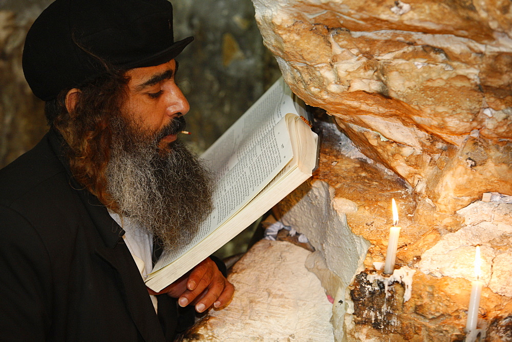 Woman praying in Elijah's cave Synagogue in Haifa, Israel, Middle East