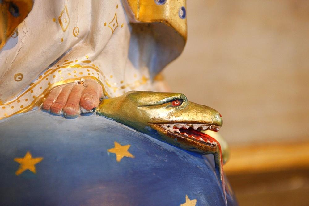 Virgin trampling evil snake in Saint-Nicolas de Veroce church, Haute Savoie, France, Europe