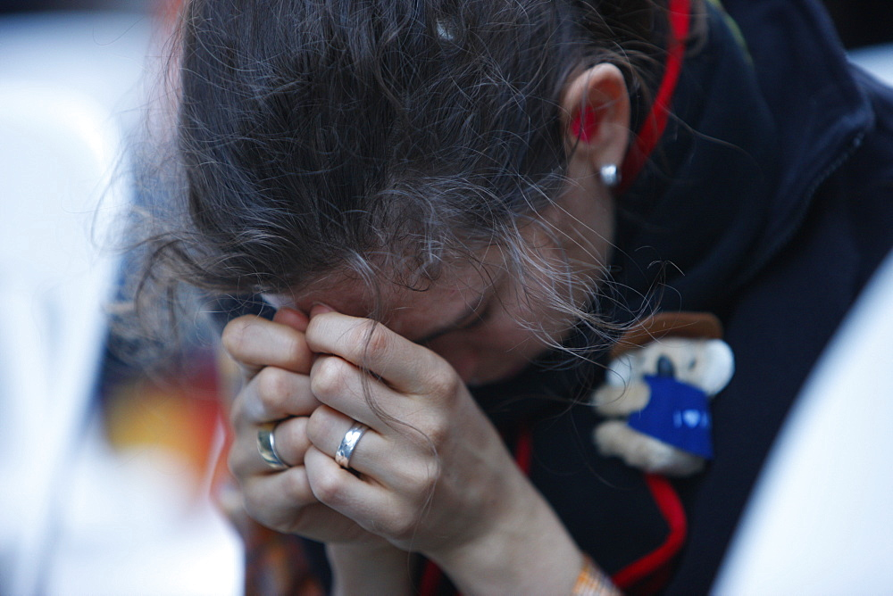 Catholic in prayer, World Youth Day, Sydney, New South Wales, Australia, Pacific
