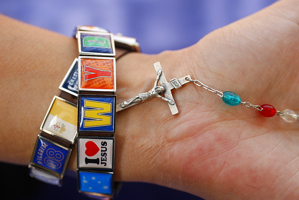 Woman with World Youth Day bracelet holding rosary, Sydney, New South Wales, Australia, Pacific